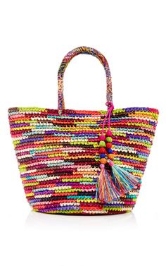 Guyaquil, Ecuador native Stephany Hollihan de Sensi-Contugi brings her country's artisan accessories to an international audience with her luxury accessories line, infused with a modern aesthetic. Handcrafted in Ecuador from local materials, this **Sensi Studio** bag exudes vibrant vacation chic in kaleidoscopic hues and playful tassels.