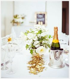 Gold confetti on a crisp white tablecloth - how classy!