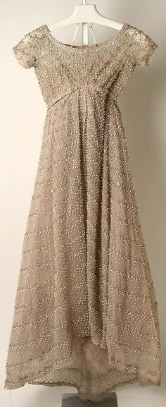 Christian Dior Evening dress 1959 by designer Yves Saint Laurent. Image c. The…