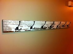 Reclaimed wood coat rack: made with old piece of fence wood I got from a farm for $5. Length is 5'.  Hooks purchased from Signature Hardware.