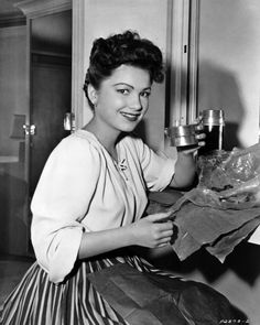 The camera catches Anne Baxter on her lunch break.