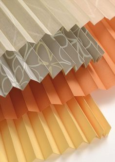 Soft orange hues for Luxaflex Plisse blinds. Teamed with on trend greys and structured pattern.  #Luxaflex #blinds #orange #pleats