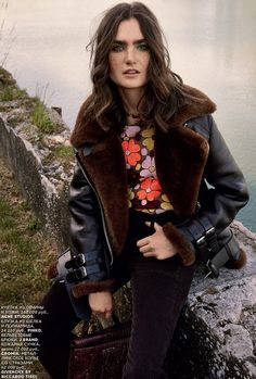 The October 2015 issue of Vogue Russia puts the spotlight on bohemian, seventies inspired style with this editorial featuring Mariia Kyianytsi. Posing for Bjarne Jonasson of Atelier Management, the brunette sports layered fall looks including luxe furs, ornate embroideries and high-waist trousers styled by Katerina Zolototrubova. Related