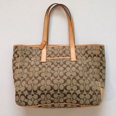 """Coach Tote / Handbag With Brown Trim & Tan Leather Coach Tote features interior: 1 zipper and 2 slip pockets. Exterior: front 1 slip pocket and 2 slip pockets on the sides. 15 1/2 """" L X 4"""" W X 11 1/2"""" H Lightly worn no rips, little bit stains on the bottom and on the side, other than that it's very good Coach Tote.          Add to Cart  Coach Bags Totes"""