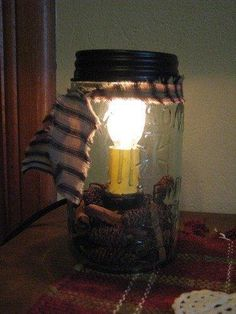 Pint Mason Jar Candle Lamp Compliment the primitive decor on an end table or the top of a small bookshelf when you add this Pint Mason Jar Candle Lamp. This pale green glass Pint Mason Jar Candle Lamp Pint Mason Jars, Mason Jar Candles, Mason Jar Lighting, Mason Jar Crafts, Mason Jar Lamp, Diy Hanging Shelves, Diy Wall Shelves, Small Bookshelf, Light Bulb Vase