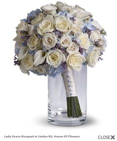 Cream white roses and light blue hydrangeas... Literally the epitome of my favorite ideas for a wedding bouquet and also my favorite flowers!