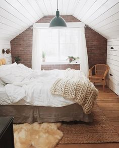 Love the brick & shiplap in this converted attic bedroom