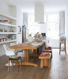 kitchen island, wooden table and perfect shelving (and build-in tv) in an Amsterdam apartment