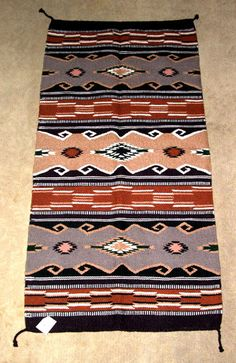 "A beautiful thickly woven wool rug with a distinct southwestern flair.  32x64"" with tassled corners. $79.95 #homedecor #throwrug #rug #southwestern #woven #wool"