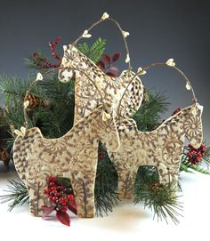 A horse for Christmas. Made out of porcelain, the Christmas Horse ornament starts out as a slab - antique lace is pressed into the clay - fired