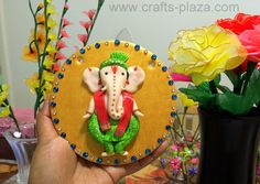 Ganesha wall/front-door decor made with polymer clay on a ceramic tile.
