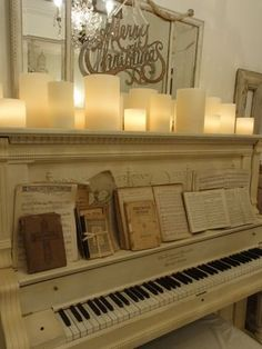 Upright piano, vintage Christmas sheet music, and glowy candles.  Cozy. I really like the painted piano...different.