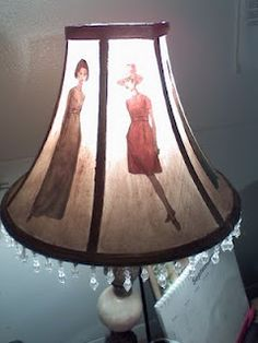 Mod Podge and paint on fabric lamp shade.  Cool 70's look