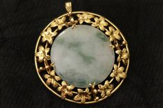 Signed Mings Pendant/Pin. 14K. Round white/green Jade