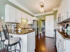 Hardwood floors, granite countertops with white cabinetry 10600 Leafwood Ln, Austin, TX 78750