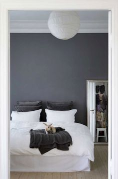 Charcoal gray makes the white bedding look so fresh and crisp.