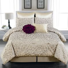 Guest bedroom 8-Piece Emma Flower Queen Comforter Set in Silver and Beige - Beyond the Rack.  Lightweight white, solid-color or printed plain weave, satin weave, or flannel cotton or cotton/polyester blends are the most common types of sheeting, although linen and silk may also be used, including in combination. Goose or duck down and other feathers are frequently used as a warm and lightweight filling in duvets and comforters.