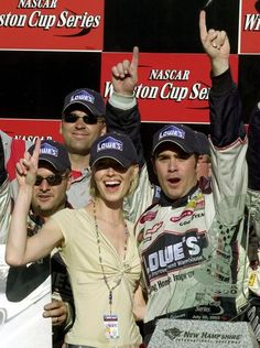 Jimmie Johnson, celebrating with girlfriend Chandra Janway, won three Sprint Cup races in 2003, including both races at New Hampshire International Speedway.