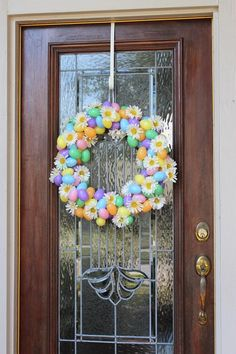 Last Thursday, the last thing I needed to be doing was crafting. We had  company coming for the weekend and floors that were in major need of  sweeping, window sills that needed dusting, and a baby that refused to nap.  Despite all the above, I decided an Easter wreath must be made. Right the