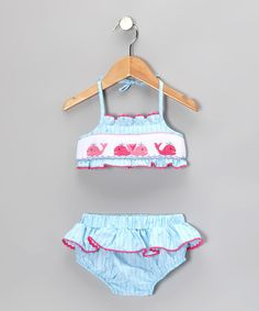 This soft swimsuit is ready to soak up some rays. Charming sea life is sweetly stitched on the front, while ruffle trim adds girly flair to both pieces.Includes top and bottoms65% polyester / 35% cottonMachine wash; tumble dryMade in El Salvador