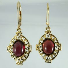 14k Yellow Gold Drop Earrings with Oval Shaped, Cabochon Cut Garnets. - $300