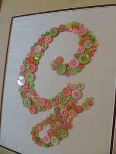 "Baby Nursery Monogram in Mix of Pink and Green Buttons -- Unique Letter Art in Ready-to-Frame 11""x14"" Size (frame not included). $80.00, via Etsy."