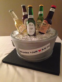 """hand sculpted """"beer bucket"""" cake. The bottles are sugar cast from molds, and fully edible.   #beer #cake #bottle #custom"""