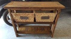 Reclaimed Farmhouse Entry Table w/ baskets. Built with scrap 2x4's. Measures 42L x 14W x 33.5H and stain with a rustic honey stain finish.