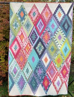 "TULA'S MYSTERY 63"" X 88"" Bed Quilt or Throw featuring Tula Pink's Foxfield Fabric by lavendersugarplum on Etsy"