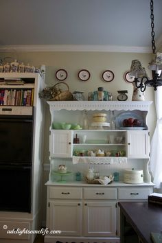 I completely changed the look in our kitchen to a Farmhouse French Country style - using soft paint colors, collectible decor, painted hutch,  French Baskets, wine bottles etc...I love the welcoming atmosphere