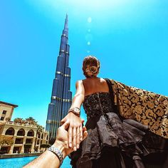 Murad Osmann one of the tallest building in the world - Burj Khalifa It is taller than the skydeck in Chicago. Also the building in 'Taiwan' is not even close - the Shanghai Tower, One World Trade Center, and The Petronas Towers are all taller.