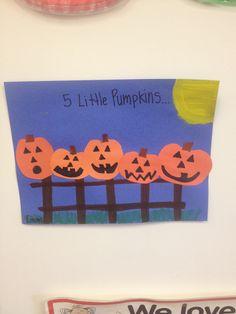 5 Little pumpkins sitting on a gate