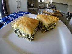 Spanakopita is a Greek spinach pie. It can be served alongside a main meal, or eaten on its own as a delicious snack. Greek Spinach Pie, Phyllo Dough, Non Stick Pan, Spanakopita, Baking Pans, Yummy Snacks, Main Meals, Eat