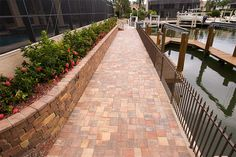 Stonehurst Autumn Blend Walkway Stonehurst is the paver of choice for projects requiring a vintage, natural slate texture. Slate Walkway, Paver Walkway, Brick Pavers, Hardscape Design, Tampa Florida, Pathways, Railroad Tracks, Outdoor Living, Environment