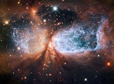 This image from the NASA/ESA Hubble Space Telescope shows Sh 2-106, or S106 for short. This is a compact star forming region in the constellation Cygnus (The Swan). A newly-formed star called S106 IR is shrouded in dust at the centre of the image, and is responsible for the surrounding gas cloud's hourglass-like shape and the turbulence visible within. Light from glowing hydrogen is coloured blue in this image.