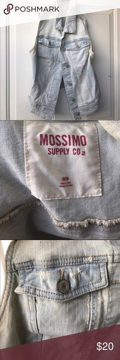 Light blue / Acid washed denim jacket / vest 🙌🏽 I wore this once 2 years ago. It'll keep you pretty warm for a vest and it's a really nice material. The jacket is not short on the back. It just came out looking that way. It's a nice piece paired with summer / spring clothing :) Mossimo Supply Co Jackets & Coats Vests