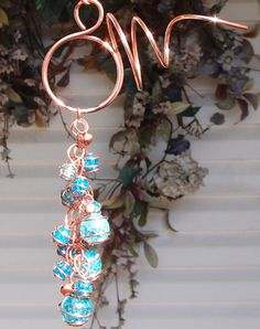 I love the blue & copper combo used in this wind chime! This is truly unique and beautiful. To make this a moving metal indoor remedy, you could connect it to a small battery operated twirler so it is in motion on a desktop or wall. Lovely! You could special order one without the bells from this Etsy vendor so that it is quiet if used inside. #FengShui #MovingMetal