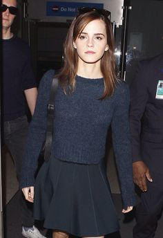 Emma Watson- cropped blue jumper with black skater skirt. Cute.