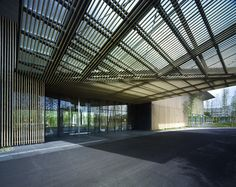 Garden Terrace Miyazaki by Kengo Kuma and Associates. Located on the site of a former factory, Garden Terrace Miyazaki comprises a single two-storey building that features bamboo-clad walls and a large sloping roof with overhanging eaves. A faceted timber canopy shelters the entrance to the hotel, leading through to a reception where guests are faced with a view of the courtyard.