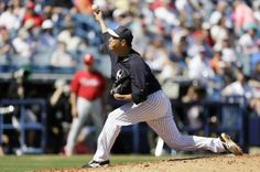 New York Yankees pitcher Hiroki Kuroda throws a pitch during the fourth inning of an exhibition baseball game against the Philadelphia Phillies Saturday, March 1, 2014, in Tampa, Fla. (AP Photo/Charlie Neibergall)