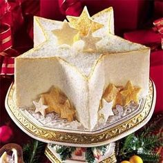 Silver and gold star shaped cake.