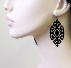 Laser cut Ethnic geometric earrings hang from NICKEL FREE Gunmetal plated over brass earwires.     Total Length is approx 2.7 inches (69mm) from the top of the ear wire.     These earrings make a bold statement, yet are surprisingly lightweight and easy to wear.     All of my jewelry comes with a gift box.  Price: $27