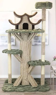 Our Premier 7 Foot Tall Cat House is a fully featured cat condo resembling a real tree. It features two tall sisal rope scratching posts, five platforms for lounging or sleeping, and a large pagoda style cat condo on top. Cool Cats, Cool Cat Trees, Diy Cat Tree, Cat Tree Plans, Carpet Cover, Cat Perch, Cat Towers, Cat Playground, Ideas