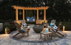 Casual Adirondack-style seating, including a bench swing hung from an angled pergola—echoed in the circular paving design—offers plenty of options for gathering around into the wee hours. Diy Pergola, Pergola Canopy, Deck With Pergola, Wooden Pergola, Covered Pergola, Pergola Kits, Pergola Ideas, Patio Ideas, Metal Pergola