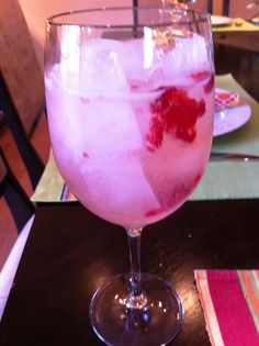 Moscoto, pink lemonade, sprite and fresh raspberries