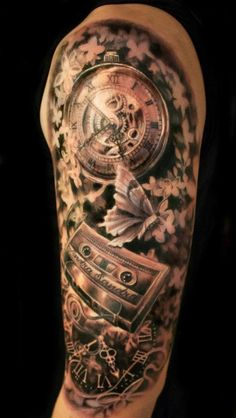 Realistic watch and cassette tattoos on arm