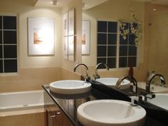 HGTV fan bochou replaced the expanse of red tile with neutral finishes and added dramatic faucets and artwork.