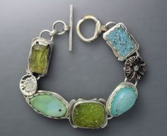 Temi Kucinski  |  Beach Dreams bracelet (on etsy.com):  A very summery sterling silver bracelet with four sparkling drusy agate cabochons and a natural yellow apatite crystal. Seven inches in length.
