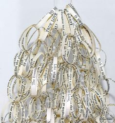 True Love cascading paper chain | from http://www.rosrixon.co.uk/page10.htm Ros Rixon UK artist uses lines of text taken from poems and other published literary works (for example How do I love thee? Sonnet 43 by Elizabeth Barrett Browning) to create delicate, thoughtful reflections on man's search for meaning and the ties that bind...