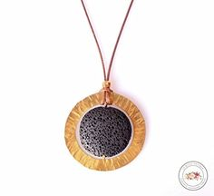 Aromatherapy necklace diffuser with volcanic lava stone in black gold and brown rustic santorini